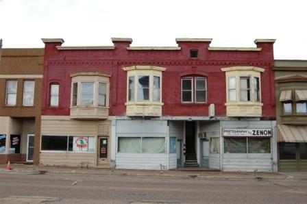 Two story italianate commercial building in brick