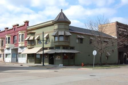Two story corner commercial building in the Queen Anne style