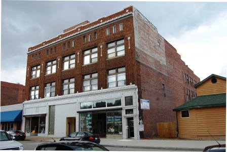 three story corner commercial building in brick