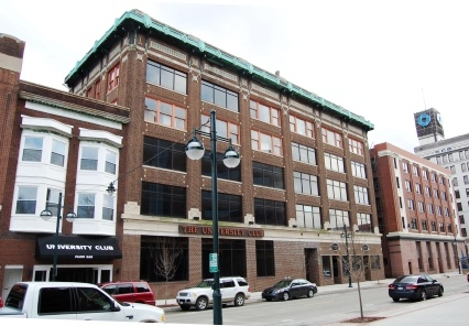 five story brick commercial building with metal cornice