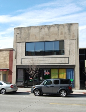 two story storefront with stone veneer