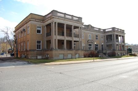 two story corner classical revival building with two, two-story porches
