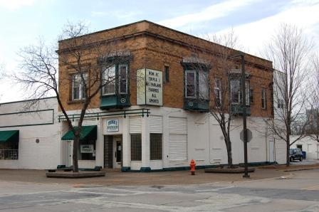 two part Italianate corner commercial building in brick