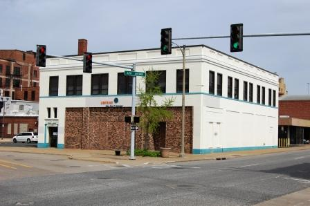 two story corner commercial building in brick